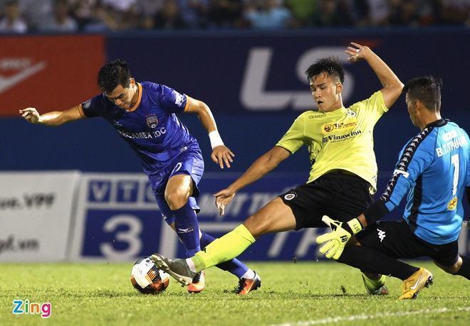 Quang Hải đổ máu, Hà Nội FC giành chiến thắng nhọc trước Bình Dương